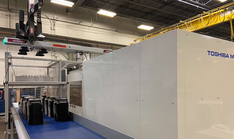 Uniphase Toshiba Molding Machine, side view cropped, black components